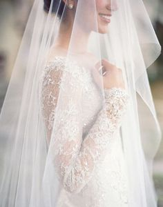 Armenian: Before the bride dons her veil she circles it above the heads of the single ladies in her dressing room to bring them luck in finding a husband. Then a happily married woman will place the veil on her head to bring the marriage luck. PC: Jose Villa Photography