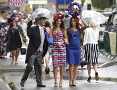 Dresses with a purpose: Two female racegoers make a statement withEU referendum-themed dresses. 14 June 2016.