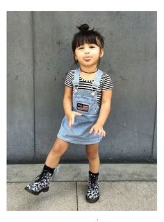[Fashion Trends] This child is wearing a inspired outfit consisting of a denim overalls dress, black and white stripe shirt, black choker necklace, and floral print Doc Martin inspired boots. Little Girl Outfits, Cute Outfits For Kids, Little Girl Fashion, Toddler Girl Style, Toddler Girl Outfits, Toddler Boys, Fashion Moda, Denim Fashion, Fashion 1920s