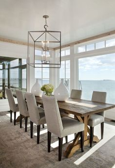 Dark raw timber table with linen coloured chairs love this look for my dining room.