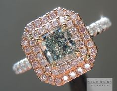 0.71ct Fancy Green VS1 Radiant Cut GIA Double Diamond Halo Ring. Total carat weight is 1.34ct and green - pink - white tri color diamond ring.