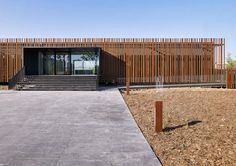 corten steel fence | Weathered rods of Corten steel surround the exterior of the Centre d ...
