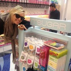 Maria Sharapova poses with products from her Sugarpova candy line.