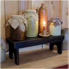crocks ~ Love this setting with the bench, covered crocks and candle ~ so welcoming and peaceful!