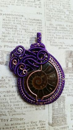 Ammonite wrapped in purple and copper by Maiden Oregon Studios