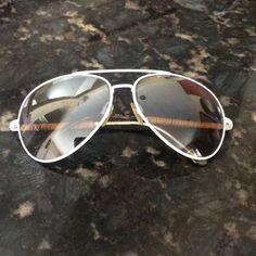 Ralph Lauren aviator sunglasses HOST PICK White trim Ralph Lauren avaiator sunglasses. Has bamboo on sides. There are some scratches on lenses, can be seen in pic#4 Ralph Lauren Accessories Sunglasses