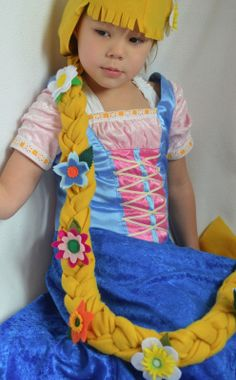 ikat bag: Wig  Ava doesn't like the idea of a wig, but she does like the idea of a braided rope covered with flowers
