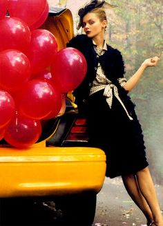 Ballons may be cliche, but coming out of a cab, they are not!