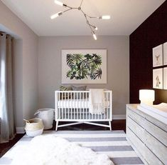 20 beautiful modern nurseries for baby to bloom into. Minimalism leaves room for baby to grow into their space. Sadly I don't have the source for this neutral beauty. But that banana palm print'll knock my socks off for years to come.