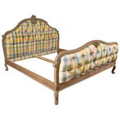 """A king-sized Louis XV style country French bed. Custom quality by Don Rousseau, This fun checkered upholstered in light pastel colors headboard and foot-board is tufted and sits on a thick and supportive Louis XV Styled frame. The fame with a center support.   Interior measurements 77.25"""" X 79"""".  Assembled Dimensions 80.0ʺW × 90.0ʺD × 61.0ʺH"""