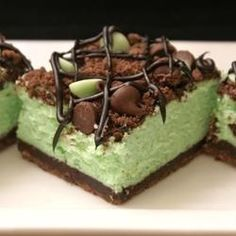 "St. Patrick's Chocolate & Mint Cheesecake Bars - Another pinner says: ""It was very yummy. Loved the crust. Smells wonderful baking,! I would suggest letting them completely chill over night before eating because it made a huge difference in the taste and then we couldn't stop eating them!! A real crowd-pleaser!"""