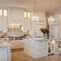 Lighted cabinets in island in a white kitchen