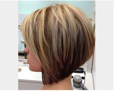 Layered & Angled Bob Hair Cut Style for Thin Hair: Instead of choosing between being a blonde or brunette, why not to opt for both? This crisp cut blends chunky blonde highlights with a deep chocolate hue for a standout style.