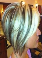 short hairstyle with blonde highlights on dark hair, hairstyle from the side