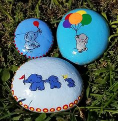 This listing is for a troop of cute elephants parading across a field of light blue. Three elephants of various sizes, two carrying red and yellow flags with a border of yellow on red dots on this painted rock.  ****************************************************************