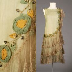 Silk chiffon flowers on gold stems adorn this green silk & tiered silver lace evening dress @KSUMuseum