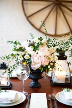 I like the brown table with the slightly black/blue urn and the various natural flowers.