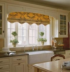 Dream treatment, toile scalloped Roman shade presents as valance when raised, privacy when lowered.