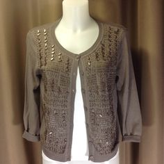 Chico's beaded cardigan Neutral all- year taupe color, 3/4 sleeve cotton and rayon cardigan. All beads intact. Part of label not fully sewn (pic 4). Chico's size 0 fits 6/8. Like new condition. Chico's Sweaters Cardigans