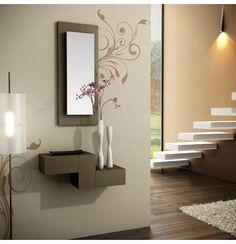 Consola para su recibidor en estilo moderno. El espejo con puerta lateral en la que se esconde un portallaves y consola en dos alturas.