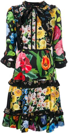 Gucci floral print dress. Gucci presents this classic and eye-catching black floral print dress to its AW17 collection. Expertly crafted in Italy from fine silk, the dress is the perfect statement choice of clothing for a range of parties and occasions. It features a short length, panelled 3/4 sleeves, a floral print, a ruffled design, a bow on the front and a button fastening.
