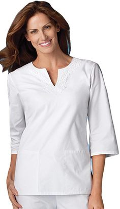 Style Code: This sleeve tunic features novelty keyhole neckline embellished by beautiful venice lace applique, front bust darts, front patch pockets, side vents and back elastic for flattering shape. Center back length measures Scrubs Pattern, White Scrubs, Medical Uniforms, Nursing Uniforms, Medical Scrubs, Nurse Scrubs, Cherokee Scrubs, Nurse Costume, Womens Scrubs