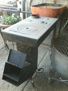 rocket stove and grill Diy Rocket Stove, Rocket Mass Heater, Rocket Stoves, Kitchen Stove, Stove Oven, Jet Stove, Fabrication Metal, Stoves Cookers, Stove Heater