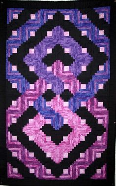 Celtic Log Cabin Quilt Pattern TE-101 (advanced beginner, twin)   Love this design...maybe not these colors. (I didn't change the description)