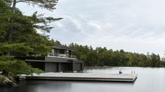 Blackened wood covers this guest cabin and boathouse, which Atelier Kastelic Buffey has designed alongside a deck for diving into an Ontario lake. Underwater Restaurant, Luxury Boat, Guest Cabin, Beaux Villages, Lake Cabins, Dezeen, Exterior, House Design, House Styles