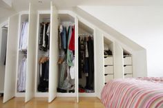 idea for closet built ins in master, not sloped though, just wall full of closet space and storage drawers.