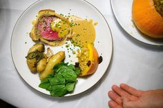 Beef Wellington with Roasted Potatoes and Wilted Greens / Adam Goldberg