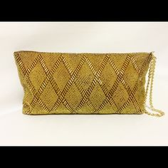 "Vintage Gold Beaded Clutch Simply amazing clutch! Gold beaded, highlighted with a diamond pattern. Featuring a zipper top closure, one interior pocket, fully lined. YKK zipper with chain wrist strap. 10.5"" X 5.5"" X .5"" Bags Clutches & Wristlets"