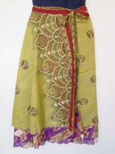 """The Long Magic Skirt is made of 100% Sari Silk from India. Each is a unique work of art. There are 2 layers of contrasting fabric, one just a few inches shorter than the other. The skirt is reversible and can be tied in several ways to create different looks. The longest layer flows 30"""" from the fully adjustable waistline. The skirt wraps and ties so you can make it fit exactly how you like. It can also be worn as a dress or beach cover-up! The material is new or like new vintage silk."""