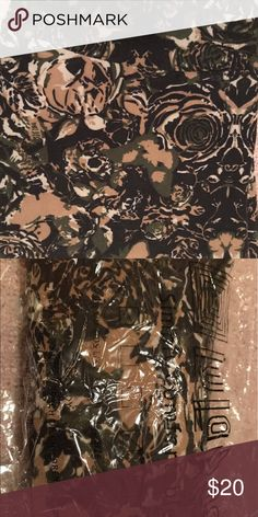 """LuLaRoe """"Floral Camo"""" Leggings These are a fun floral and butterfly print legging that give the appearance of camo.  They look great with back, gray or green tops. Very comfortable! Only washed and worn once. LuLaRoe Pants Leggings"""