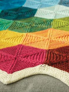 Knitting Pattern for Polygon Blanket - This afghan is made of individual garter stitch hexagons that are knit individually and assembled. Great stash buster and portable project! Blanket as shown: 29 1/2″W x 37 1/2″L http://intheloopknitting.com/stash-buster-knitting-patterns/
