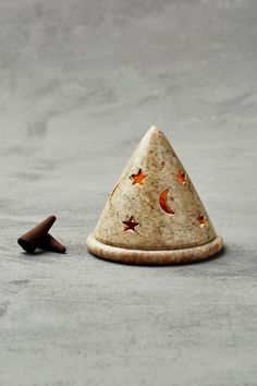 Use ~ http://www.cadecga.com/category/Incense/ Moon Star Incense Cone Burner