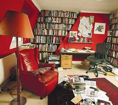 Love all the red in this library. I want to live in a house where the rooms are nothing but libraries, one after another...