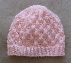 Baby's lace Beanie with rib band - knitting pattern - Molly This baby Beanie has a rib band, is worked in a lovely lace stitch then has a stocking stitch crown. To fit head: 35 cm ins]. Baby Cardigan Knitting Pattern Free, Knit Beanie Pattern, Knit Headband Pattern, Baby Hats Knitting, Crochet Baby Hats, Baby Knitting Patterns, Crown Pattern, Newborn Knit Hat, Newborn Hats
