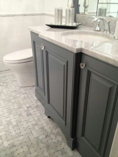 Gray cabinets with white marble counter top