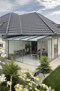 wintergarten gestaltung falttüren glas essbereich