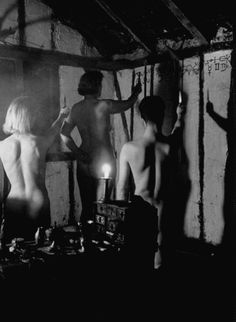 Caption from LIFE. Beneath cabalistic symbols, nude witches raise ritual knives to invoke their gods at a meeting. Their nakedness outrages many people, but witches claim this represents the putting aside of worldly things.