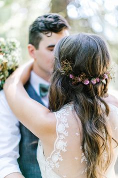 What a beautiful way to incorporate flowers into your hair for the big day!