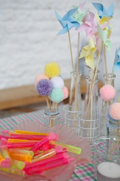 DIY table centres, pastel pom poms and paper windmills instead of flowers