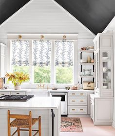 White kitchen with black ceiling, pink floors. See this Instagram photo by @hollyaudreywilliams