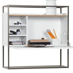 The Muto Secretaire Desk is mounted easily on a wall, creating the thoroughly modern perception of a floating piece. Metal frame and ample storage.