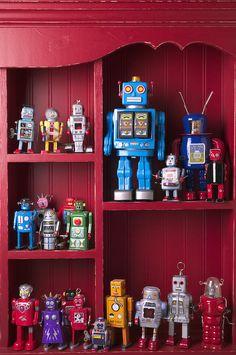 Toy robots on shelf  Photograph  - Toy robots on shelf  Fine Art Print