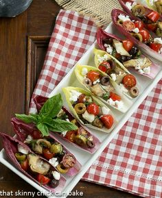 Mediterranean Endive Boats   Two bite salads from That Skinny Chick Can Bake