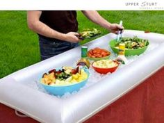 Great idea for a party, inflatable pool lounge full of ice to keep the food fresh