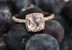 Cushion white sapphire in 14k rose gold diamond ring-via Etsy.