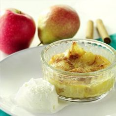 An indivdiual apple and pear gratin in a glass dish with ice cream on the side and apples in the background. Pudding Desserts, Mini Desserts, Delicious Desserts, Dessert Recipes, Cored Apple, Gratin Dish, British Baking, Glass Dishes, Something Sweet